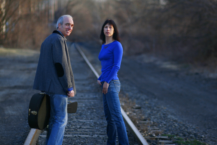 Friction Farm (being Aidan Quinn and Christine Stay) walking along empty railway line